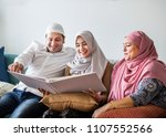 muslim family looking in a... | Shutterstock . vector #1107552566