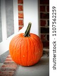 a pumpkin on the front porch. | Shutterstock . vector #1107562259