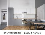 open kitchen in gray and white... | Shutterstock . vector #1107571439