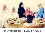 muslim family having a ramadan... | Shutterstock . vector #1107577076