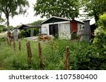 small houses  usually in... | Shutterstock . vector #1107580400