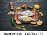 two fish on a tray  fresh... | Shutterstock . vector #1107581474