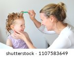 Small photo of Washing out Head lice in the hair of a child