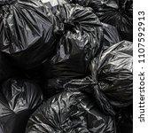 background garbage bag black... | Shutterstock . vector #1107592913