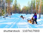 woman at husky dogs sled in... | Shutterstock . vector #1107617003