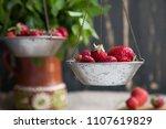 strawberries on rustic hand... | Shutterstock . vector #1107619829