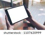 mockup image of hands holding... | Shutterstock . vector #1107620999