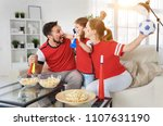 a family of fans watching a... | Shutterstock . vector #1107631190