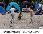 children among tents on aug. 10 ... | Shutterstock . vector #1107650390