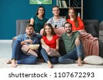 young people watching tv at home | Shutterstock . vector #1107672293
