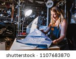 young woman sewing with sewing... | Shutterstock . vector #1107683870