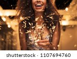 cheerful young woman holding... | Shutterstock . vector #1107694760