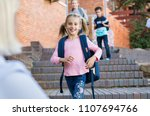 happy cute girl running with... | Shutterstock . vector #1107694766