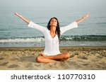 pretty woman doing yoga on the... | Shutterstock . vector #110770310