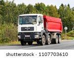 Small photo of Yaroslavl region, Russia - August 26, 2011: White dump truck MAN TGA 41.480 at the interurban freeway.