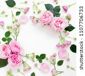 Stock photo floral frame composition with roses flowers leaves and buds on white background flat lay top 1107706733