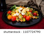 delicious fresh salad and olive ... | Shutterstock . vector #1107724790