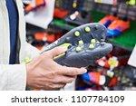 hands of a man with football... | Shutterstock . vector #1107784109
