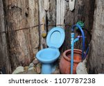 Blue Toilet On A Natural...