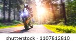 motorbike on the forest road... | Shutterstock . vector #1107812810