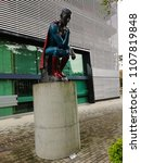 Small photo of COLOMBIA, MEDELLÍN – MAY 6, 2018: Superman 2008: Sculpture made in bronze by Nadin Ospina. The piece is located next to the Mercado del Río