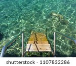 stairs to the cristal clear... | Shutterstock . vector #1107832286