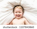 one years girl baby on the bed | Shutterstock . vector #1107843860