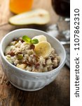 healthy oatmeal porridge with... | Shutterstock . vector #1107862310