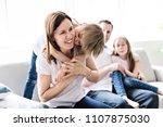 family of four having fun on... | Shutterstock . vector #1107875030