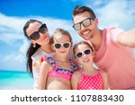 young beautiful family taking... | Shutterstock . vector #1107883430