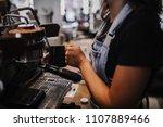 barista steaming milk on... | Shutterstock . vector #1107889466
