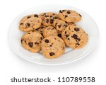 Pile of chocolate chip cookies on a dish isolated on white background