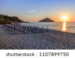 paradise beach at sunrise.... | Shutterstock . vector #1107899750