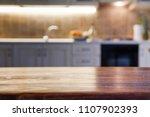 blurred kitchen interior and... | Shutterstock . vector #1107902393