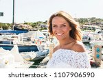 beautiful blond woman walking...   Shutterstock . vector #1107906590
