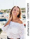 beautiful blond woman walking...   Shutterstock . vector #1107906599