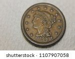 The face of an 1854 cent.