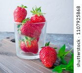 appetizing ripe strawberry in... | Shutterstock . vector #1107925868