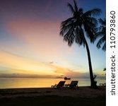 Beautiful sunrise at Beach with palms - stock photo