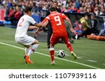 Small photo of Moscow, Russia - June 5, 2018. Russian midfielder Alan Dzagoev against Turkish centreback Kaan Ayhan during international friendly Russia vs Turkey.