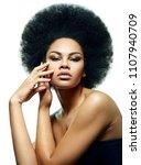 beautiful black skinned girl on ... | Shutterstock . vector #1107940709