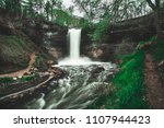 wide shot of waterfall framed...   Shutterstock . vector #1107944423