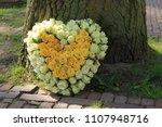 heart shaped sympathy flowers ... | Shutterstock . vector #1107948716
