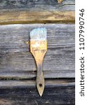 old vintage brush on a wooden... | Shutterstock . vector #1107990746