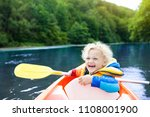 child with paddle on kayak.... | Shutterstock . vector #1108001900