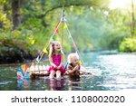 two children on wooden raft... | Shutterstock . vector #1108002020