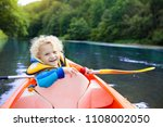 child with paddle on kayak.... | Shutterstock . vector #1108002050