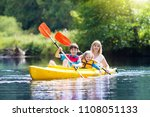 child with paddle on kayak.... | Shutterstock . vector #1108051133