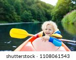 child with paddle on kayak.... | Shutterstock . vector #1108061543