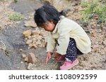 little dirty native american... | Shutterstock . vector #1108092599